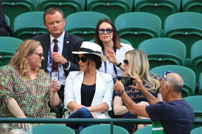 Hasan Hasanov taking a selfie as the Duchess of Sussex watches the Serena Williams match on court one (Mike Egerton/PA)