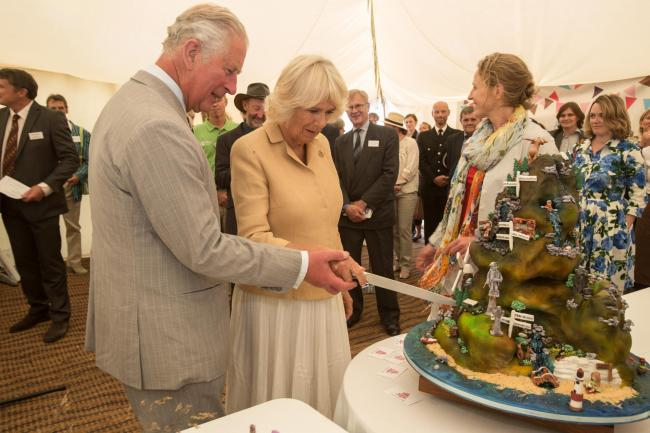 GUESTS OF HONOUR: HRH Prince Charles and the Duchess of Cornwall cut the specially made cake featuring cameos from all 15 UK National Parks