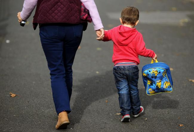File photo dated 13/10/15 of a woman and a child. The Government has been urged to extend support for families to stop children going hungry during the school holidays. PRESS ASSOCIATION Photo. Issue date: Wednesday July 31, 2019. Frank Field, chairman of