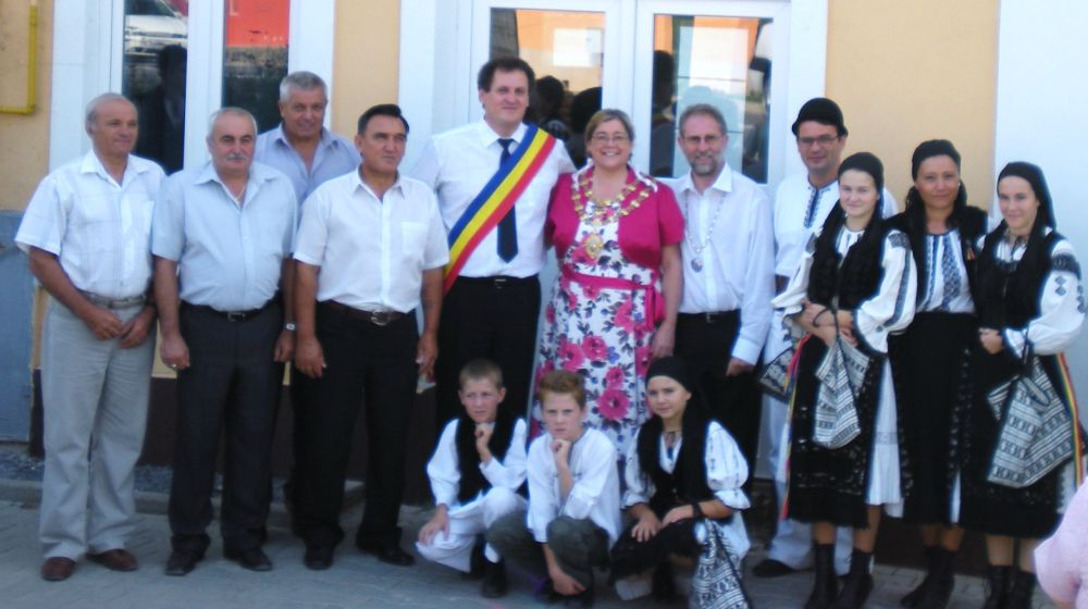 PICTURED at the twinning ceremony is Chard Mayor Cllr Jill Shortland (centre) with her consort Cllr Gary Shortland (right) and Seica Mare Mayor Nikolai Sasa (left), surrounded by town dignitaries and representatives.