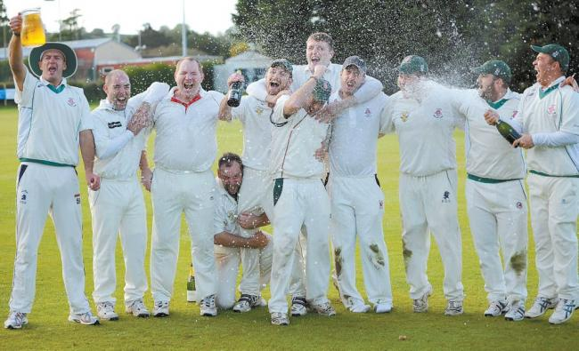 CHARD 1st XI celebrate winning the West of England League Somerset Division title.