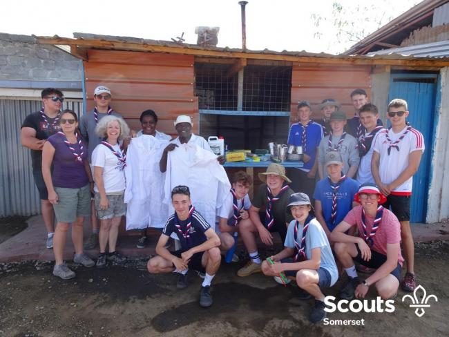 HERE TO HELP: Somerset scouts and leaders with people from the Kenyan school