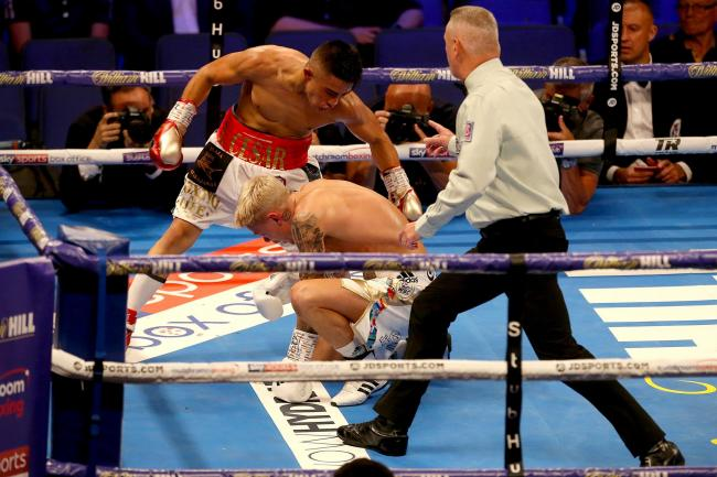 Edwards retains title after opponent hit him while on one