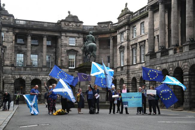 Pro-EU demonstrators outside the Court of Session in Edinburgh