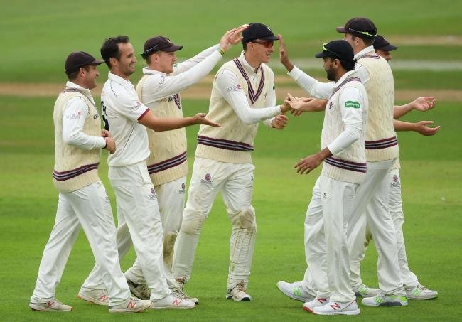 Lewis Gregory (second from left) took three early wickets on the first day against Hampshire. Pic: SCCC