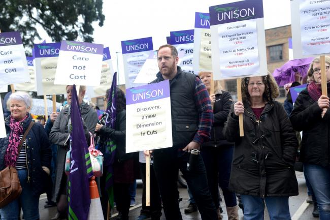 Protestors gather outsige the County Court in Taunton as they hand over a petition to try and save disability services in the Somerset area