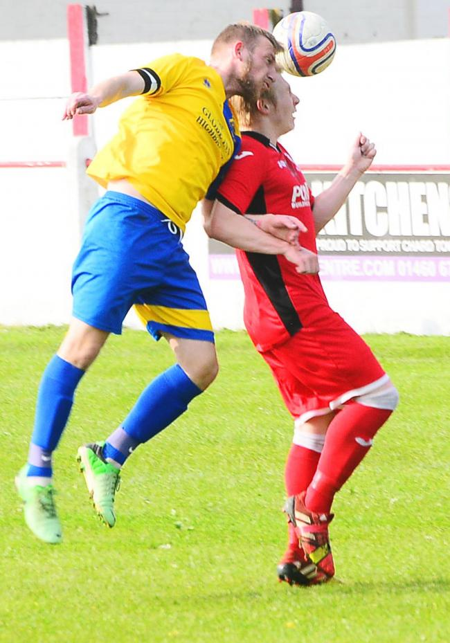 APPROACH: Ben Mear (red kit) in action for Chard Town Reserves in 2015