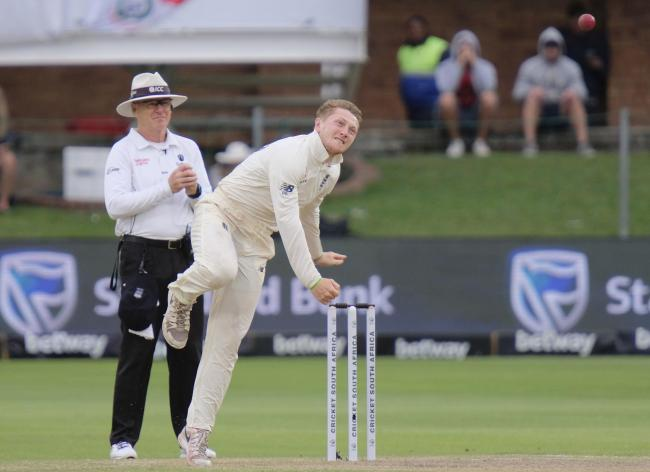 Dominic Bess of England bowls a ball during day two of the third cricket test between South Africa and England in Port Elizabeth, South Africa, Saturday, Jan. 18, 2020. (AP Photo/Michael Sheehan).