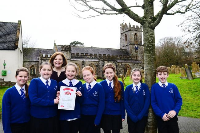 AWARD: Combe St Nicholas primary school pupils, head Christine Maxwell, and their award