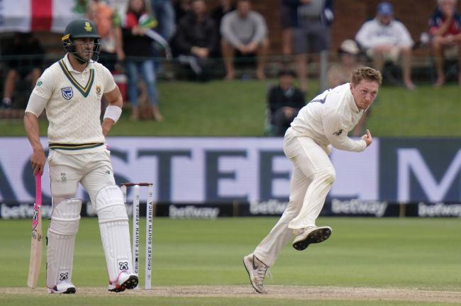 England's Dominic Bess bowls during day four of the third cricket test between South Africa and England in Port Elizabeth, South Africa, Sunday, Jan. 19, 2020. (AP Photo/Michael Sheehan).
