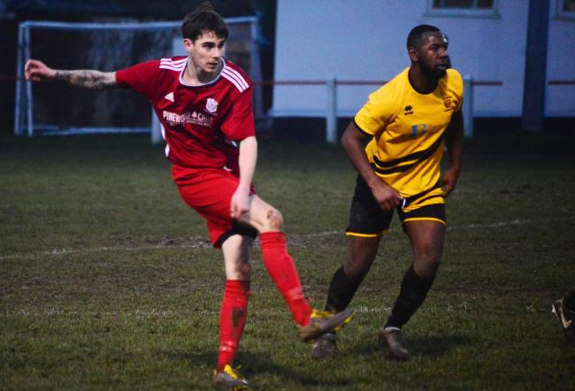 BACK: Tom Hargreaves (red kit) is one of several players to return to Chard Town. Pic: Steve Richardson
