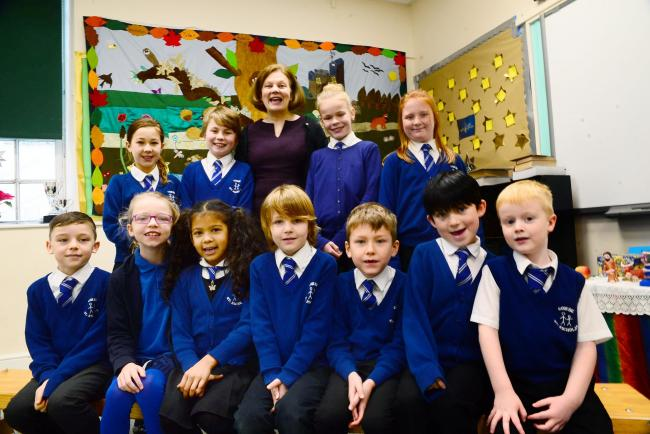 HAPPY: Combe St Nicholas Primary School pupils, with headteacher Christine Maxwell