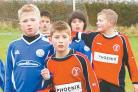 Avishayes Combe Raiders U-11s (red shirts) are pictured in action against Parcroft at the weekend.