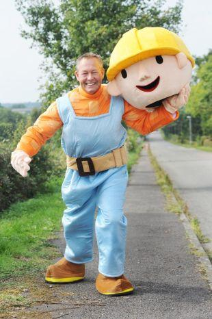 PAUL Guiver from Ashill is preparing to run the Bristol Half Marathon dressed as Bob the Builder to raise funds for SURE and FORCE. PHOTO: Steve Richardson.