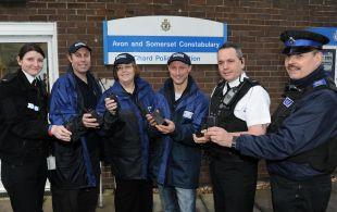 CHARD police hand over new radio link radios to Chard Street Pastors. PHOTO: Geoff Hall