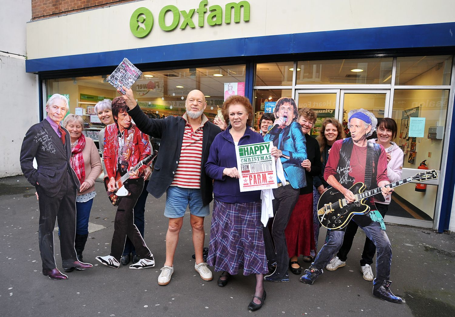 MICHAEL Eavis with volunteers from Bridgwater's Oxfam charity shop, in autumn 2013.