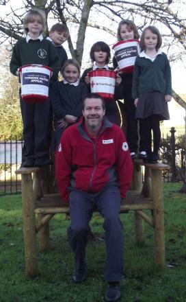 RED Cross community legacy manager Paul Morgan with, from left, Joel, Oliver, Maisie, Tyler, Chloe and Lottie. PHOTO: Iain Crabtree
