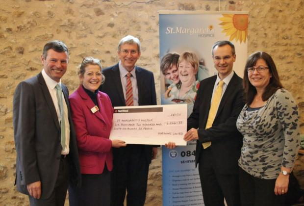 FROM left, chairman of trustees John Snell, clinical director Ann Lee, Jon Andrewes of St Margaret's Hospice, Tom Samuel and Caroline Owen of Harmonic.