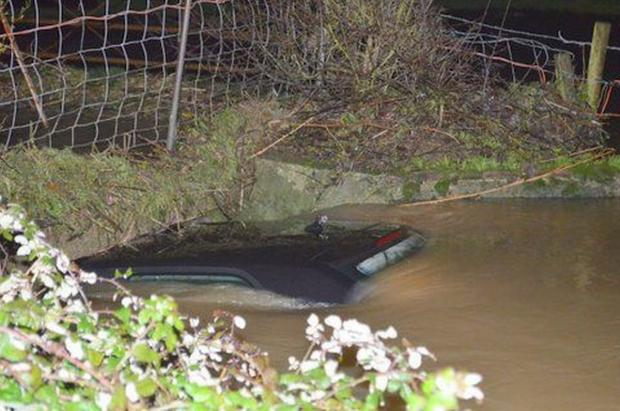 Chard & Ilminster News: Chard driver 'lucky to be alive' after car is swept into river