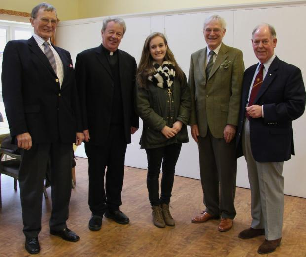 ISOBEL Worrall, centre, receives her cheque from Axminster Catenians Kevin Lazenby, Robert Draper, Bob Bannister and Paul Austin.