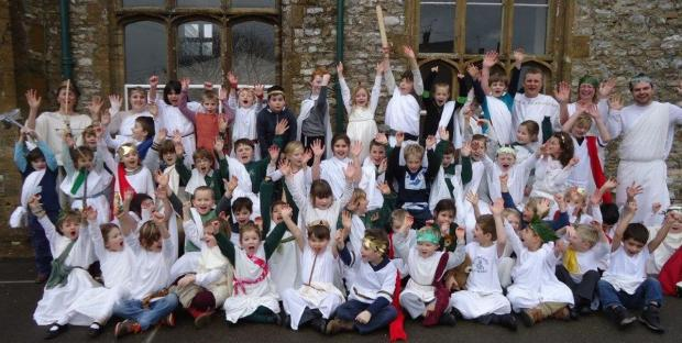 CHILDREN and staff at Buckland St Mary Primary School in their Greek outfits.