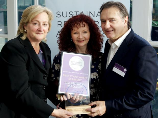 SARAH-Jane Martin, from The Belfry, receives her award from Tracey Rogers, of sponsors Unilever Food Solutions, and SRA president Raymond Blanc.