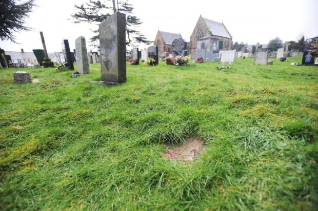Chard & Ilminster News: MICHAEL Phillips' empty grave after the memorial pot was taken.