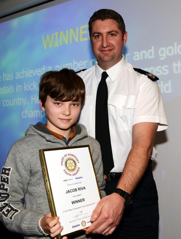 Chard & Ilminster News: JACOB Riva receives his award from Gavin Ellis, of sponsors Devon and Somerset Fire and Rescue Service.