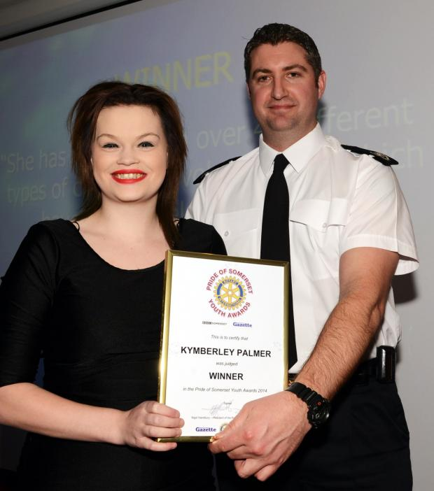Chard & Ilminster News: KYMBERLY Palmer receives her award from Gavin Ellis, of sponsors Devon and Somerset Fire and Rescue Service.