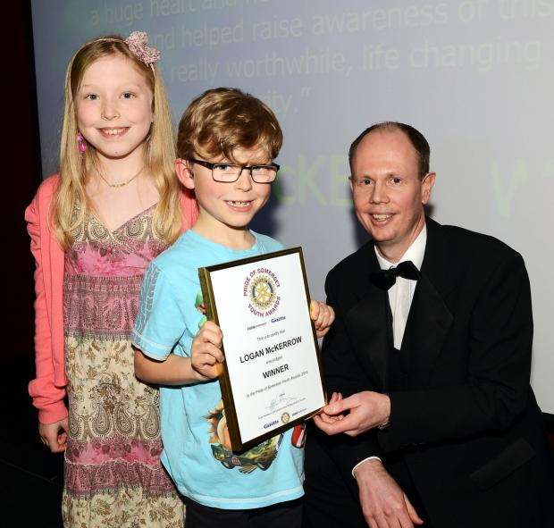 Logan and his sister collect the award from Alex Cameron, editor of the Somerset County Gazette se