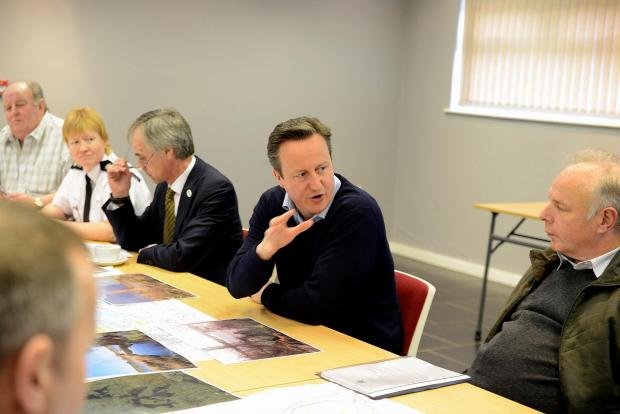 Prime Minister David Cameron speaks to Bridgwater MP Ian Liddell-Grainger and Sedgemoor councillors