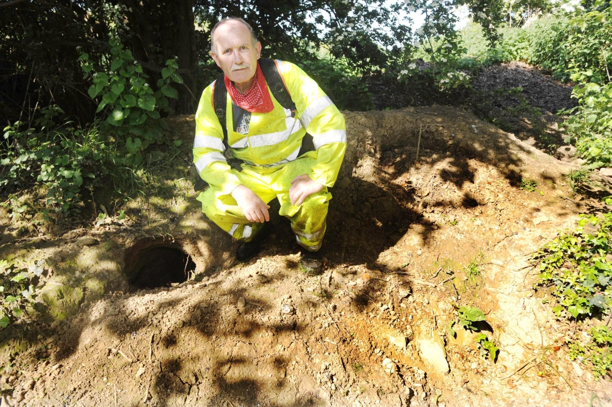 Cllr Roger Swann next to one of the setts by the old canal.