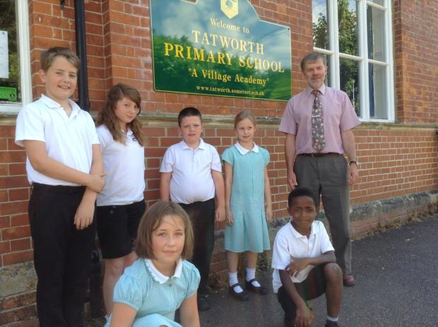 Chard & Ilminster News: David Knight with some children outside the school.