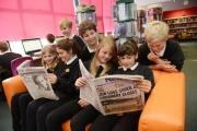 YOUNGSTERS catch up with all the local and national news.