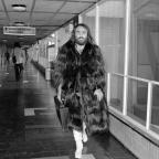 Chard & Ilminster News: Greek singer Demis Roussos leaves London's Heathrow Airport for a tour of Scandinavia in 1974