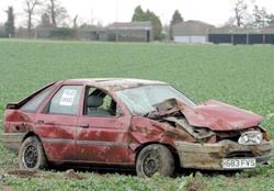 Chard & Ilminster News: Wrecked - a car in a field beside the A120 between Wix and Ramsey. Picture: TERRY WEEDEN (53807-1)
