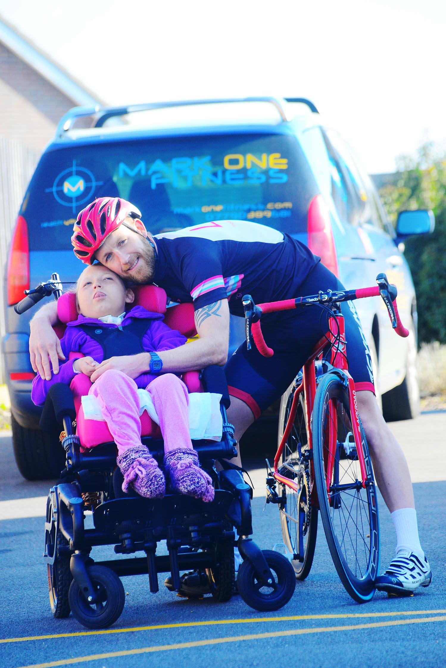 Mark Hughes with his daughter Sophie, picture last year ahead of his bike ride