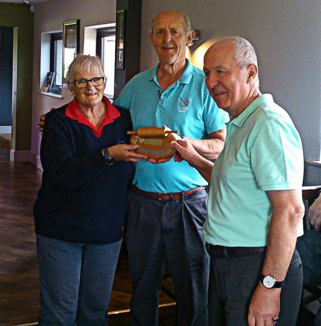 ROLLING Pin winners John Pearce and Linda McDonald receive the trophy from Nick Hill