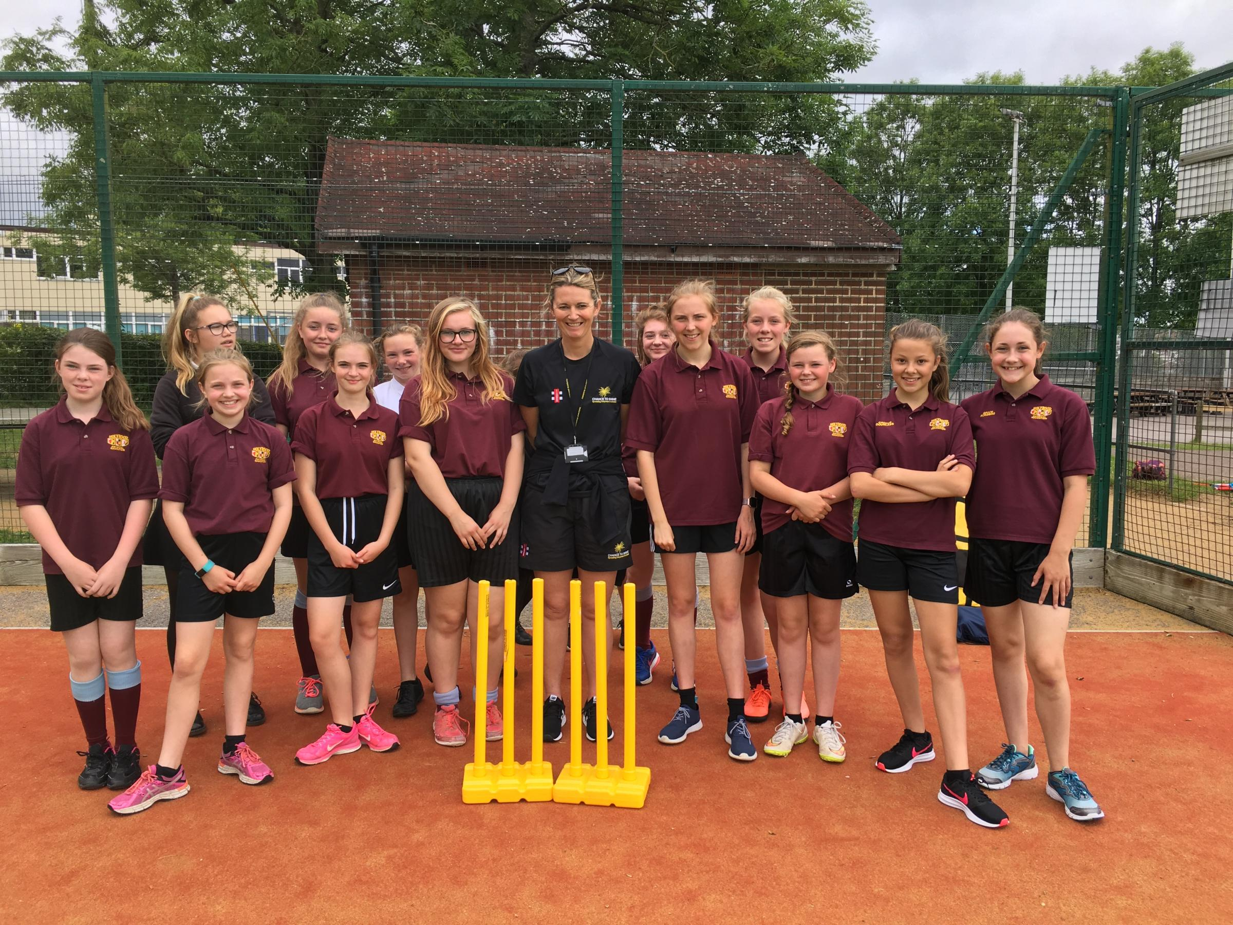 VISIT: Charlotte Edwards with Holyrood Academy girls' cricketers.