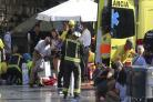 Paramedics tend to the injured in Barcelona