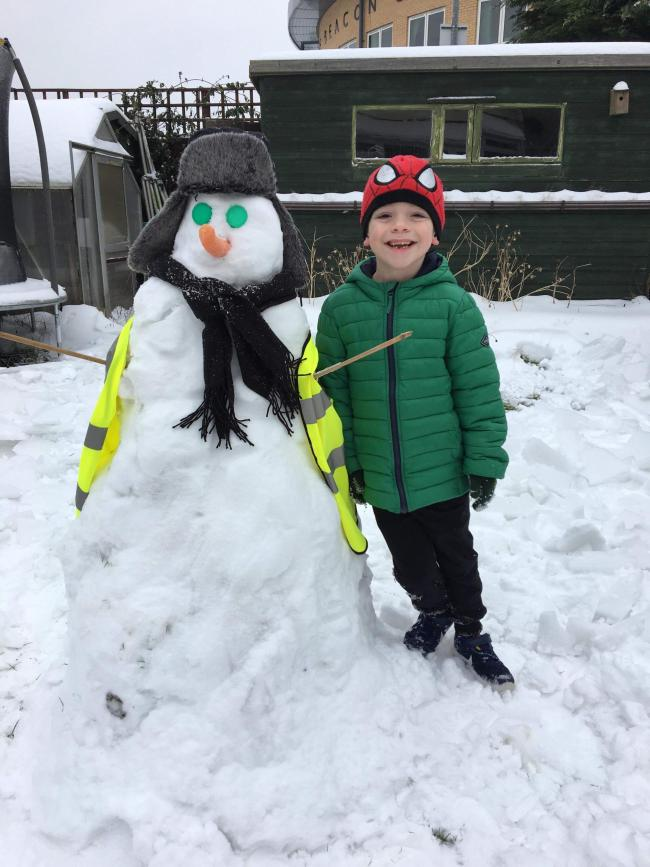 My grandson Joseph Kelly with his snowman .