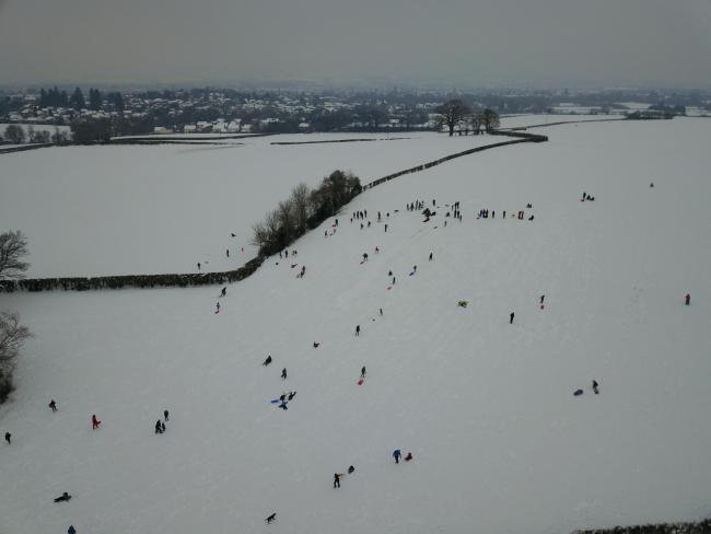 Here are some pictures taken from a drone at Cotlake Hill, above Trull, in Taunton, Somerset. As you can see people are out in force having fun sledging and enjoying the snow. 1 picture shows the whole town, another shows people sledging with the town in the background and the last one shows people enjoying the snow.