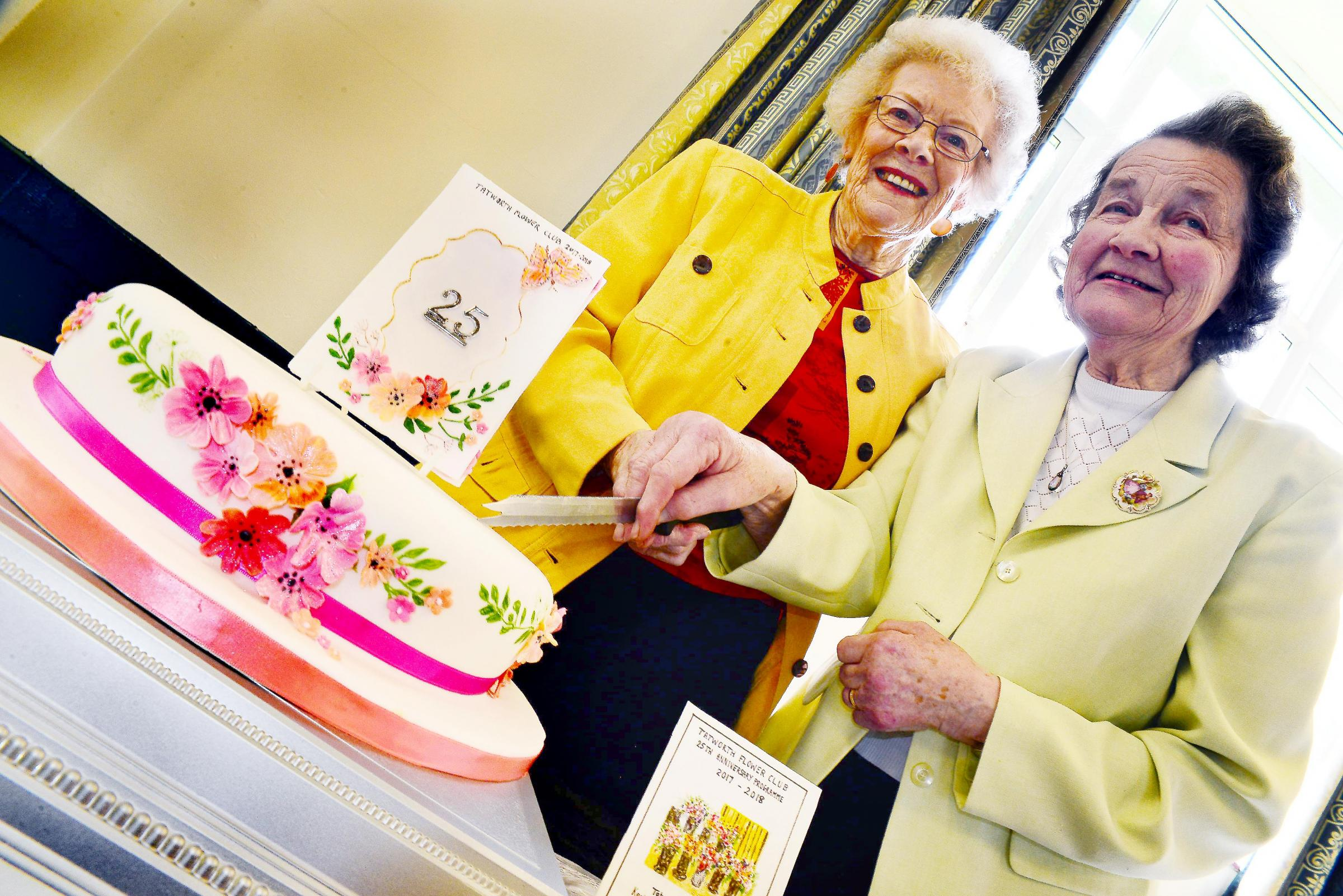 CUT THE CAKE: Long-serving honorary members Rosemary Walton and Rosalie Palmer mark the day