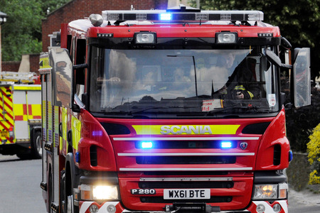 FIRE: Firefighters from Crewkerne and Yeovil rushed to Haslebury Plucknett  to fight a combine harvester fire