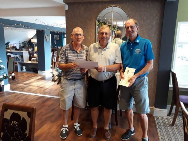 WINNERS: Mark Saunders and G. Ramsell with captain Barrie Heath (right) at Cricket St Thomas Golf Club.