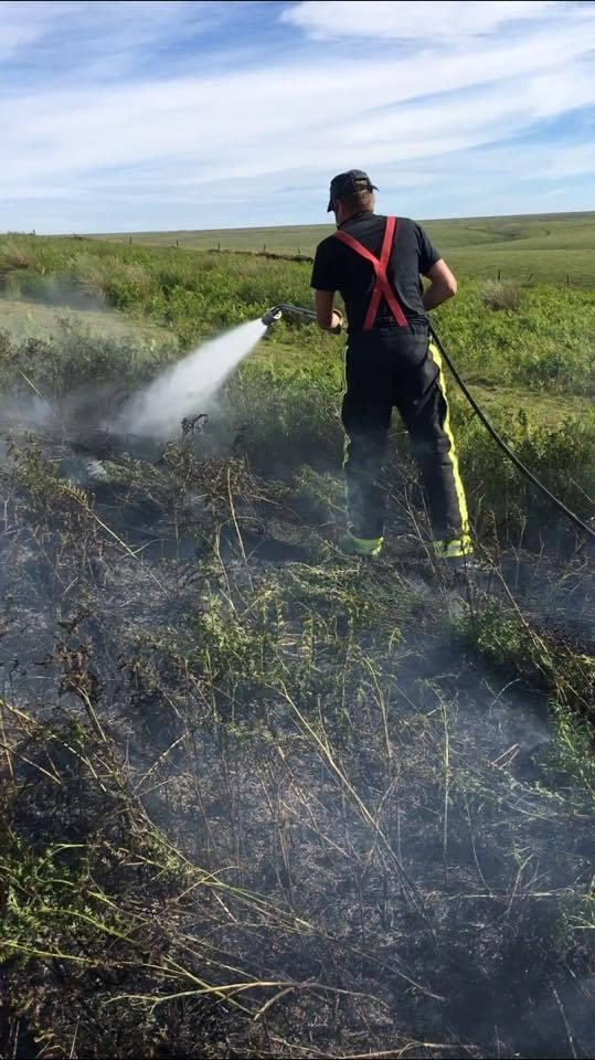 RESPONSE: Firefighters putting out a blaze on Exmoor in June 2018. PIC: Porlock Fire Service