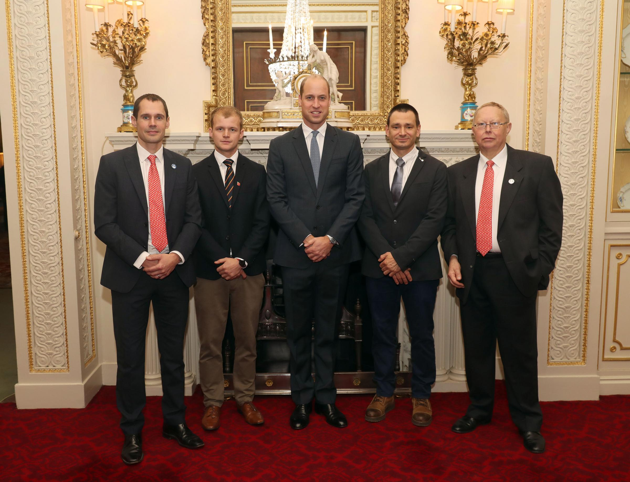 The Duke of Cambridge, with (left to right)  Chris Jewell, Connor Roe, Jim Warny and Rob Harper, as he hosts a reception at Buckingham Palace in London for the British divers who helped rescue 12 trapped boys from a cave in Thailand. PRESS ASSOCIATION Pho
