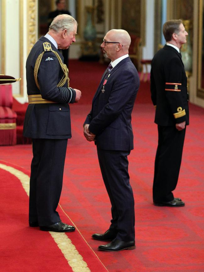 Former England cricketer Matthew Maynard receives an MBE for services to charity and sport from the Prince of Wales during an investiture ceremony at Buckingham Palace, London. PRESS ASSOCIATION Photo. Picture date: Thursday February 21, 2019. See PA stor
