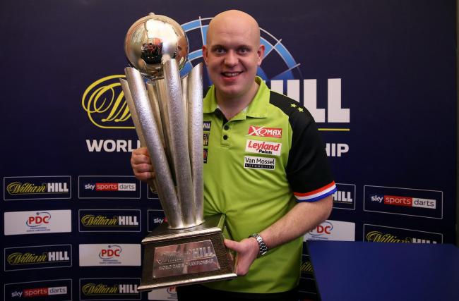 Michael Van Gerwen hold the Sid Waddell trophy after winning during day sixteen of the William Hill World Darts Championships at Alexandra Palace, London. PRESS ASSOCIATION Photo. Picture date: Tuesday January 1, 2019. Photo credit should read: Steven Pas