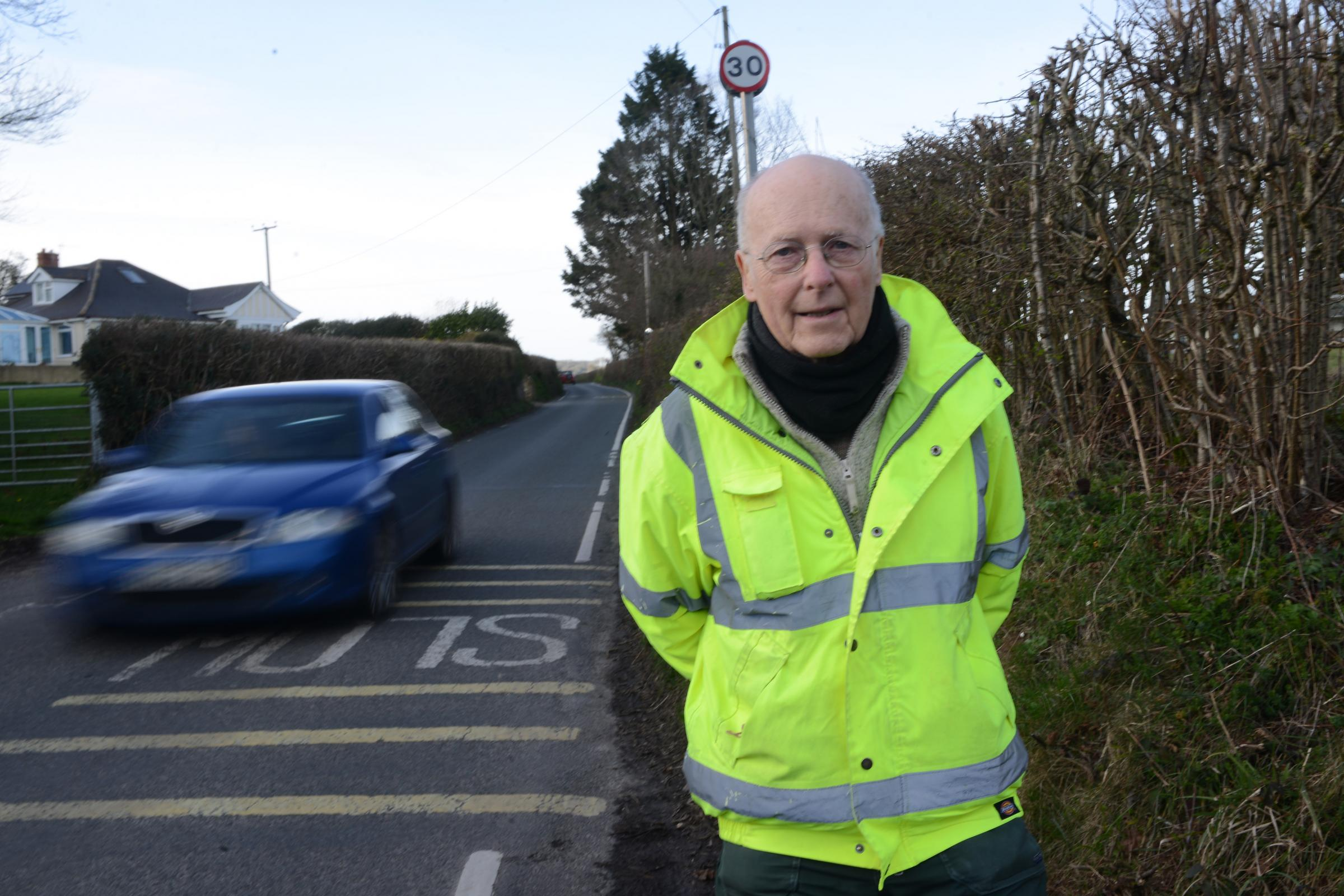 CAMPAIGNING: Cllr Andrew Turpin pictured in Forton, where road users have been losing wing mirrors